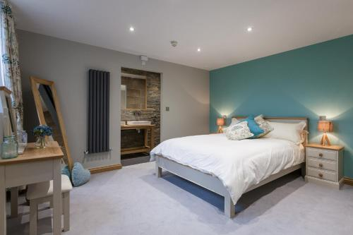 A bed or beds in a room at The Venue Serviced Apartments