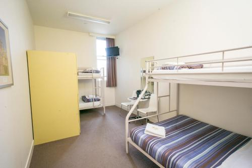 A bunk bed or bunk beds in a room at Sydney Harbour YHA