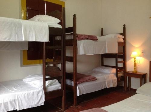 A bunk bed or bunk beds in a room at Pousada do Careca