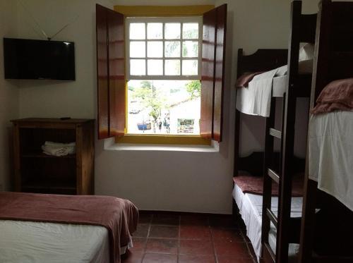 A bed or beds in a room at Pousada do Careca