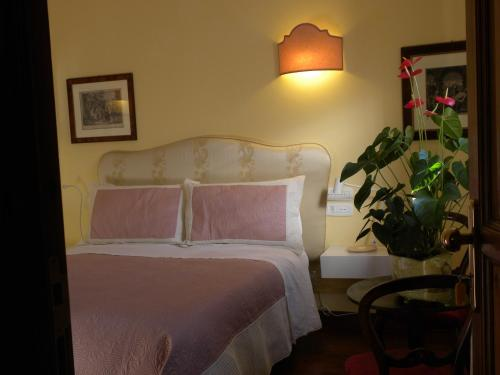 A bed or beds in a room at B&B Charme Celestino V°