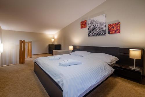 Posteľ alebo postele v izbe v ubytovaní Via Jasna Wellness Apartments