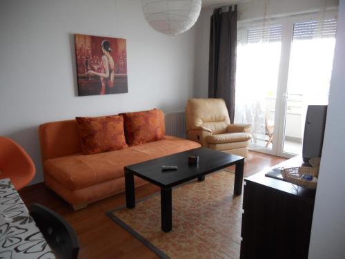 A seating area at La Perla Wellness Apartman