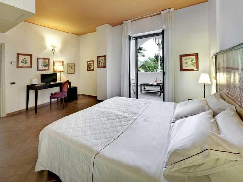 Letto o letti in una camera di Hotel Garden