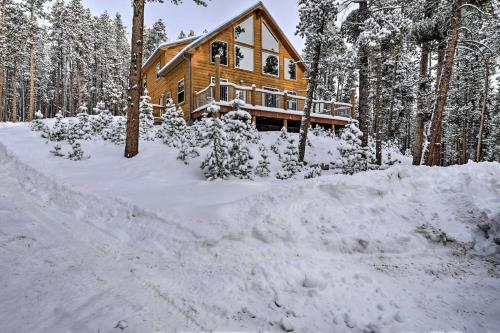 Scenic Mountain Cabin on 4 Wooded Acres and Hot Tub! during the winter
