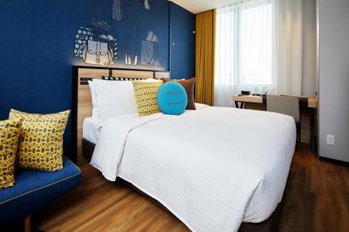 A bed or beds in a room at Citadines Namba Osaka