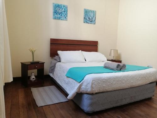 Cama o camas de una habitación en Hostal Rama & CaStle