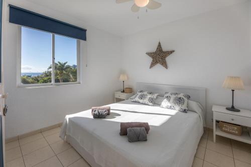 Cama o camas de una habitación en beach at 250 m, ocean view, 2 bedrooms, Wi-Fi