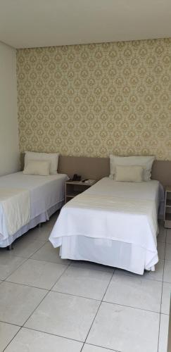 Cama ou camas em um quarto em Destak Hotel Residence