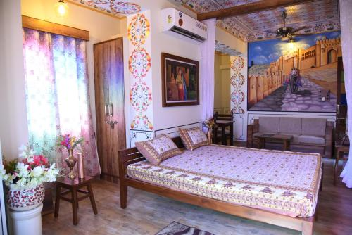 A bed or beds in a room at HERITAGE ABOVE 1