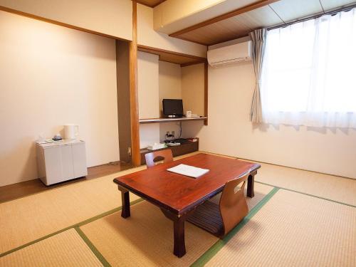 A kitchen or kitchenette at Hotel Asyl Nara Annex