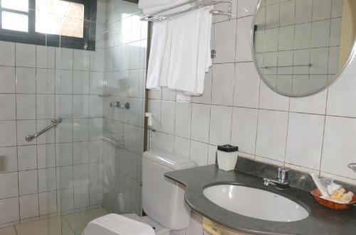 Um banheiro em Pousada Villa Harmonia