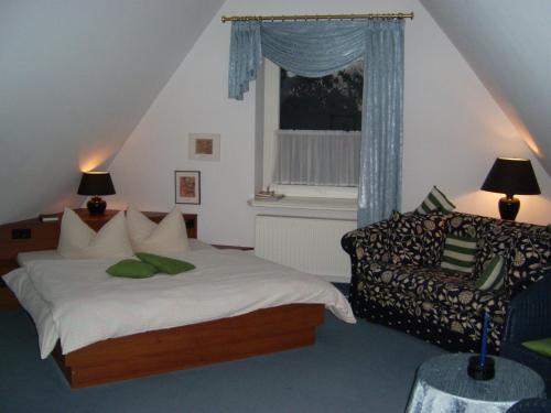 Ein Bett oder Betten in einem Zimmer der Unterkunft Villa Markersdorf