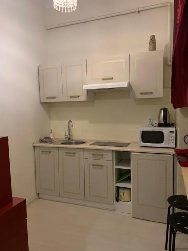 Kuchnia lub aneks kuchenny w obiekcie Golden Boutique Apartments
