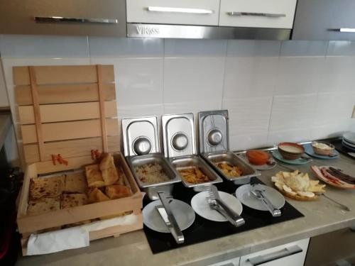 A kitchen or kitchenette at Stone Art Guest House & Camping