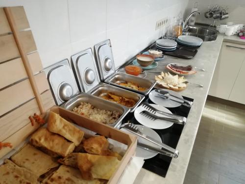 Breakfast options available to guests at Stone Art Guest House & Camping