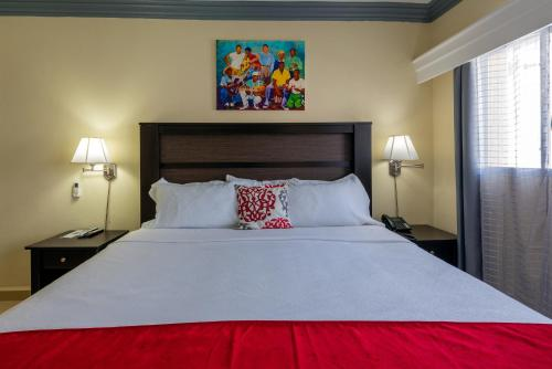 A bed or beds in a room at Baker's Suites