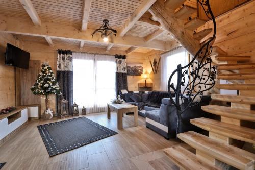Posezení v ubytování Leśny Dwór Premium Chalets Zakopane