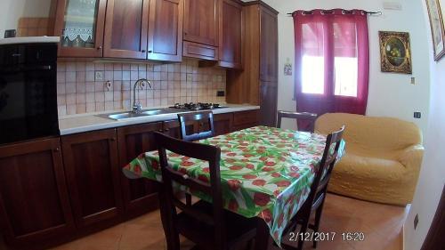 A kitchen or kitchenette at Villa Cala Creta