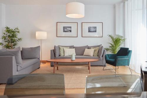 A seating area at Apartamentos La Bola Suite