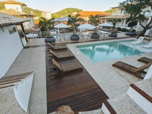 The swimming pool at or near Pousada Aroma do Mar