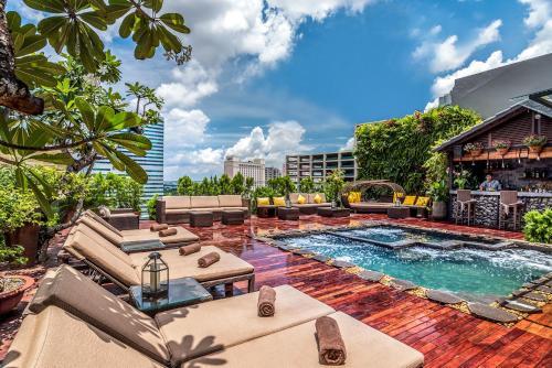 The swimming pool at or near Silverland Sakyo Hotel