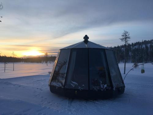 SnowLounge AuroraHut Glass Igloos & Ice Hotel during the winter