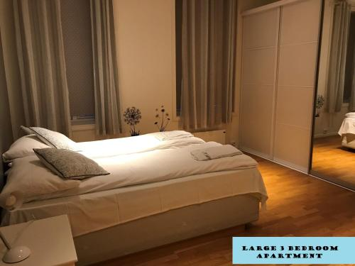 A bed or beds in a room at Norhostel Apartment