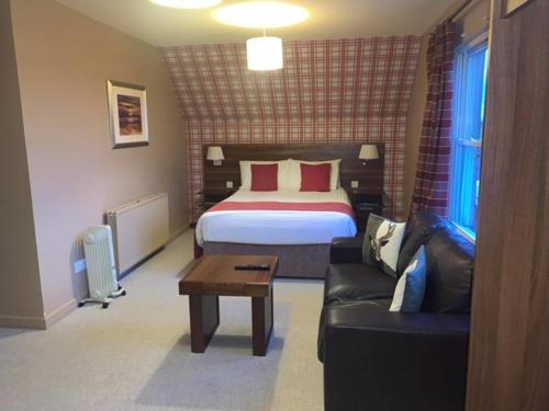 A bed or beds in a room at Chieftain Hotel