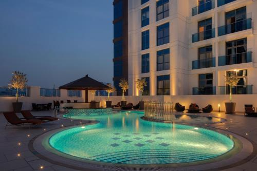 The swimming pool at or close to Hyatt Place Dubai Jumeirah