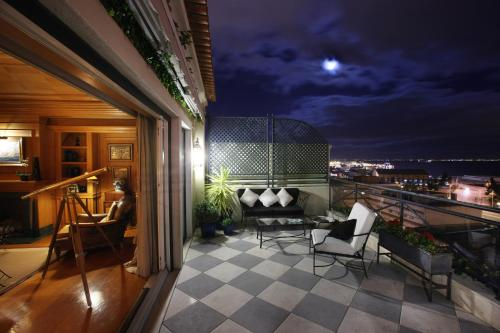 A balcony or terrace at As Janelas Verdes Inn - Lisbon Heritage Collection