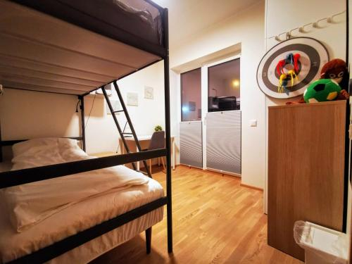 A bunk bed or bunk beds in a room at Scandian Apartments - City Park Tallinn