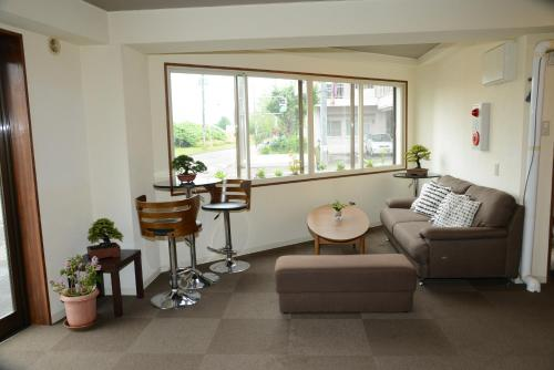 A seating area at Sapporo Guest House Nariya