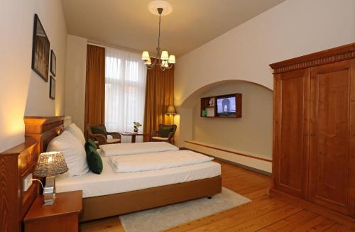Ein Bett oder Betten in einem Zimmer der Unterkunft Aparthotel Markt Fuffzehn