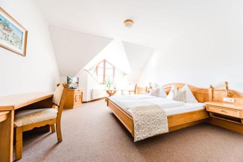 Ein Bett oder Betten in einem Zimmer der Unterkunft Das Herbst