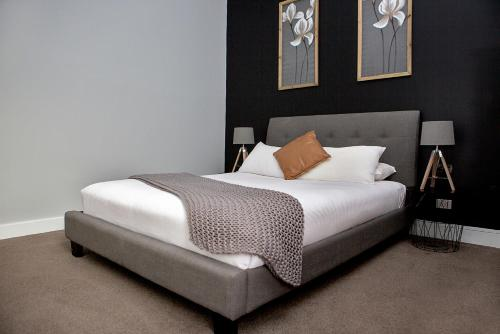 A bed or beds in a room at Revive Central Apartments