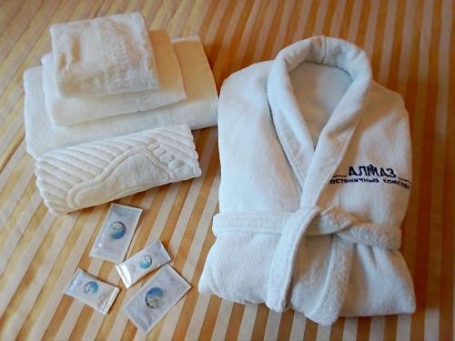 Кровать или кровати в номере Гостиничный комплекс Алмаз