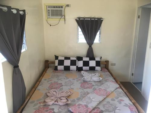 A bed or beds in a room at Anda-Divers-Enjoy Garden Resort