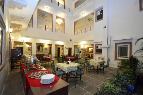A restaurant or other place to eat at FabHotel Prime Mahal Khandela