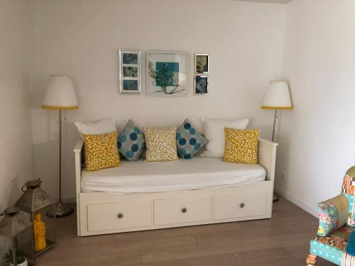A seating area at Amazing Beach & Pool Apartment with Garden