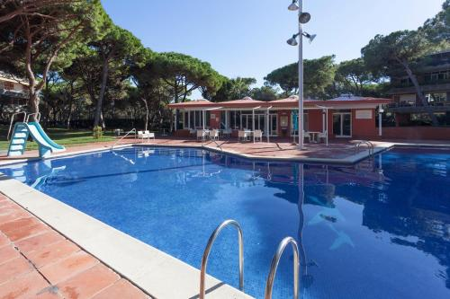 The swimming pool at or near Gavamar Castelldefels Beachfront Apartment- Direct access to the beach