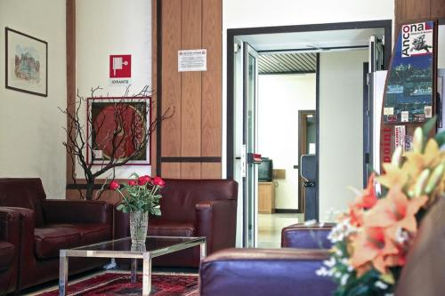 The lobby or reception area at Hotel Fortuna