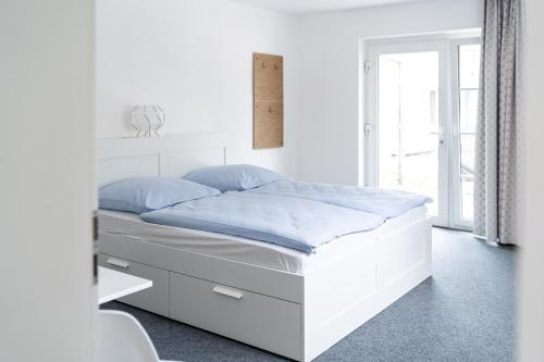 A bed or beds in a room at TEEK Hostel