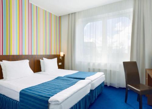 Cama o camas de una habitación en Rija VEF Hotel with FREE Parking