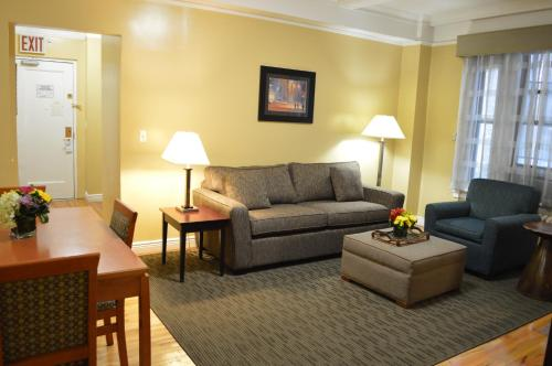 A seating area at Best Western Plus Hospitality House Suites