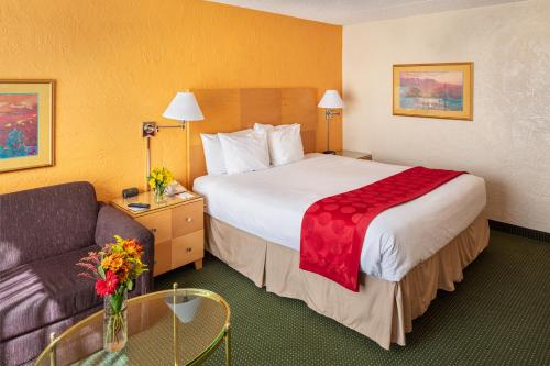 A bed or beds in a room at Ramada by Wyndham Tucson