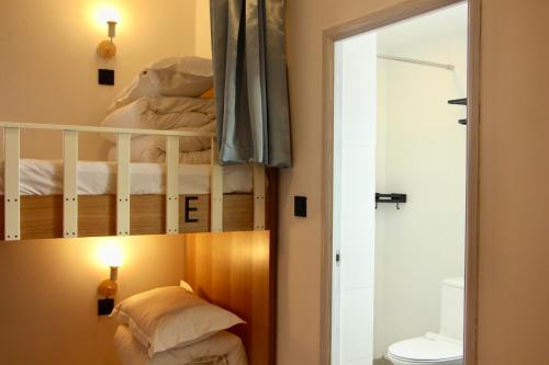 A bed or beds in a room at Travel light Guilin