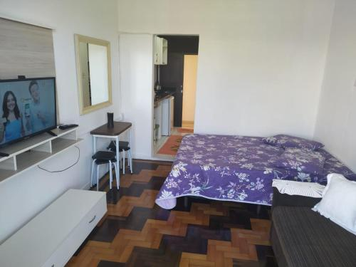 A bed or beds in a room at Paraiso Beira Mar
