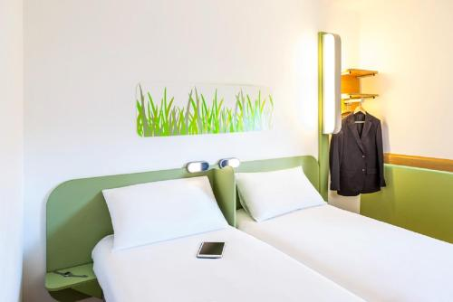 A bed or beds in a room at ibis budget Derby