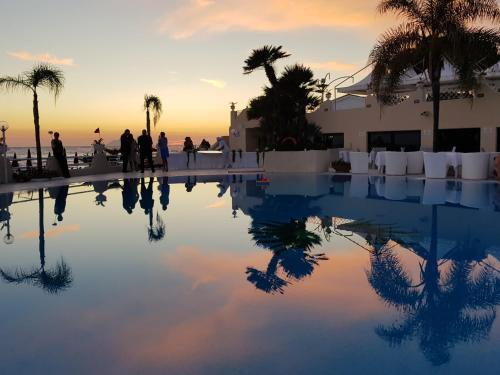 The swimming pool at or near Grand Hotel La Playa